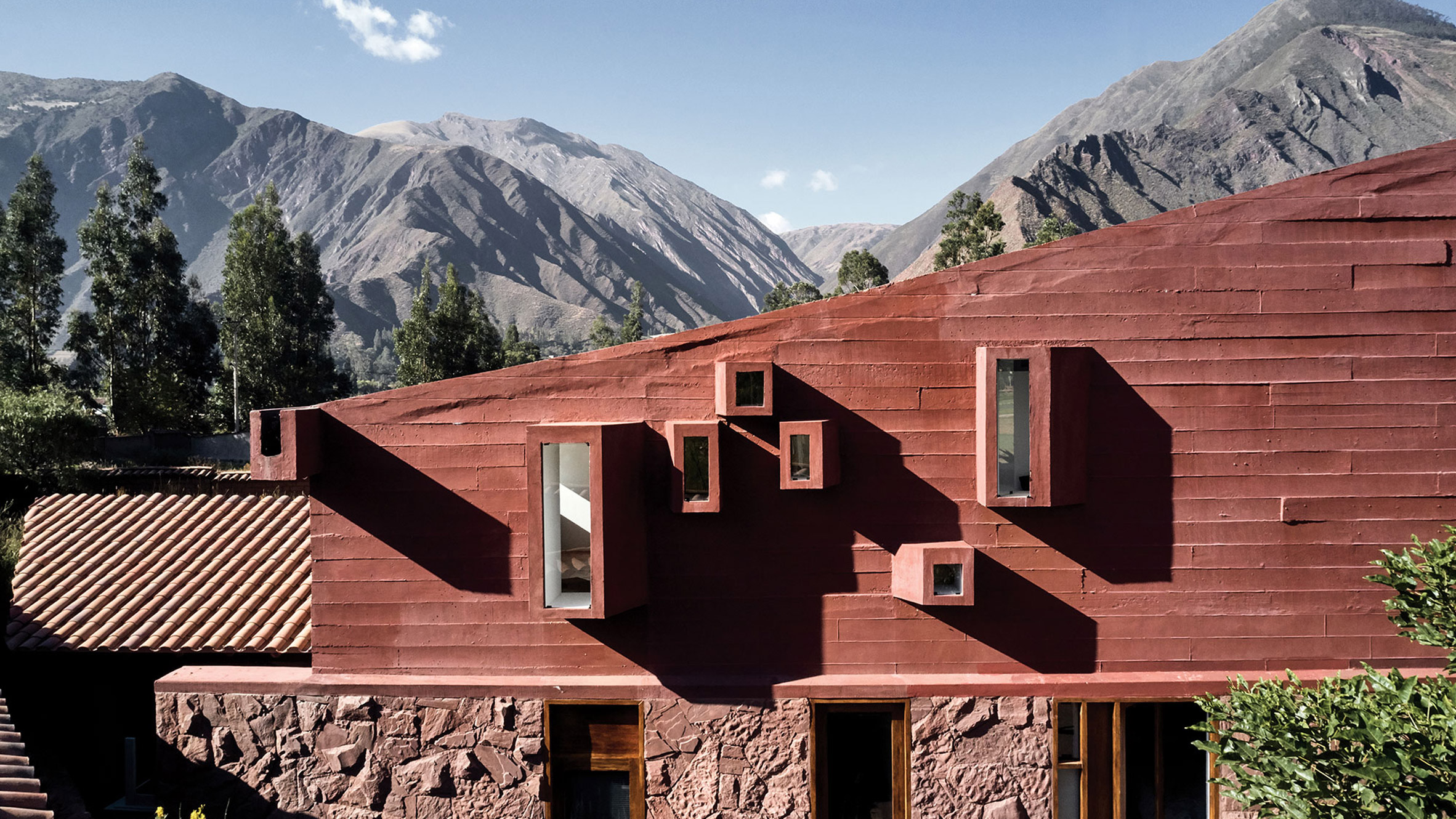 Peruvian mountains surround geometric and red Casa Huayoccari by Barclay & Crousse