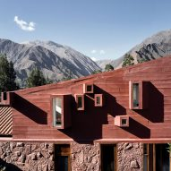 Peruvian mountains surround geometric and red Casa Huayoccari by Barclay & Crousse