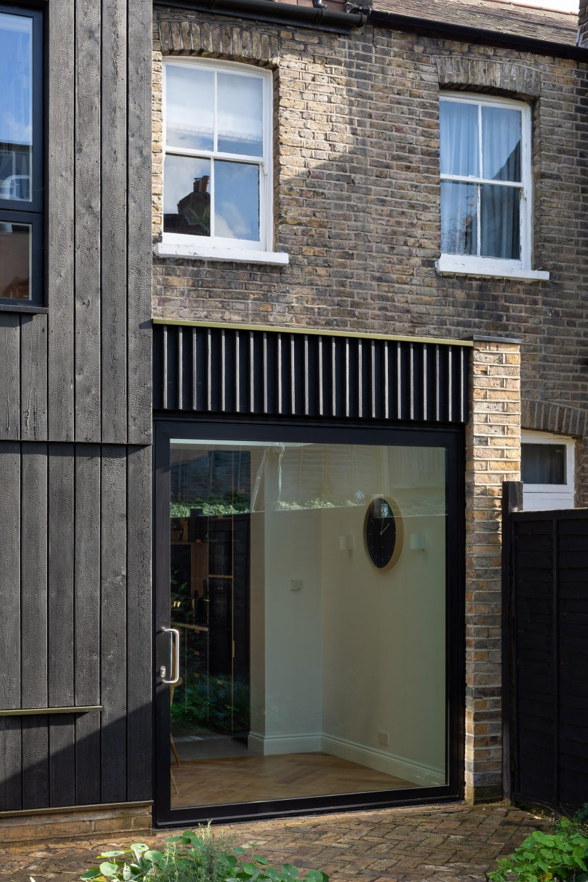The pivot door of the Charred House extension by Rider Stirland Architects in London