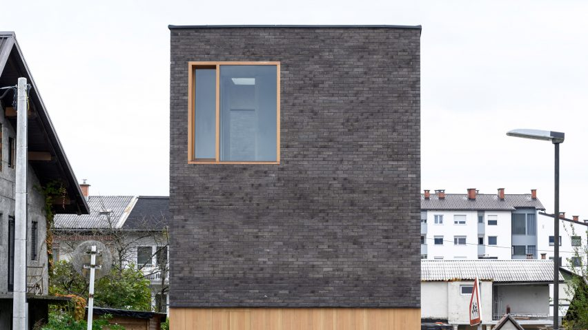 Brick facade of The Double Brick House by Arhitektura