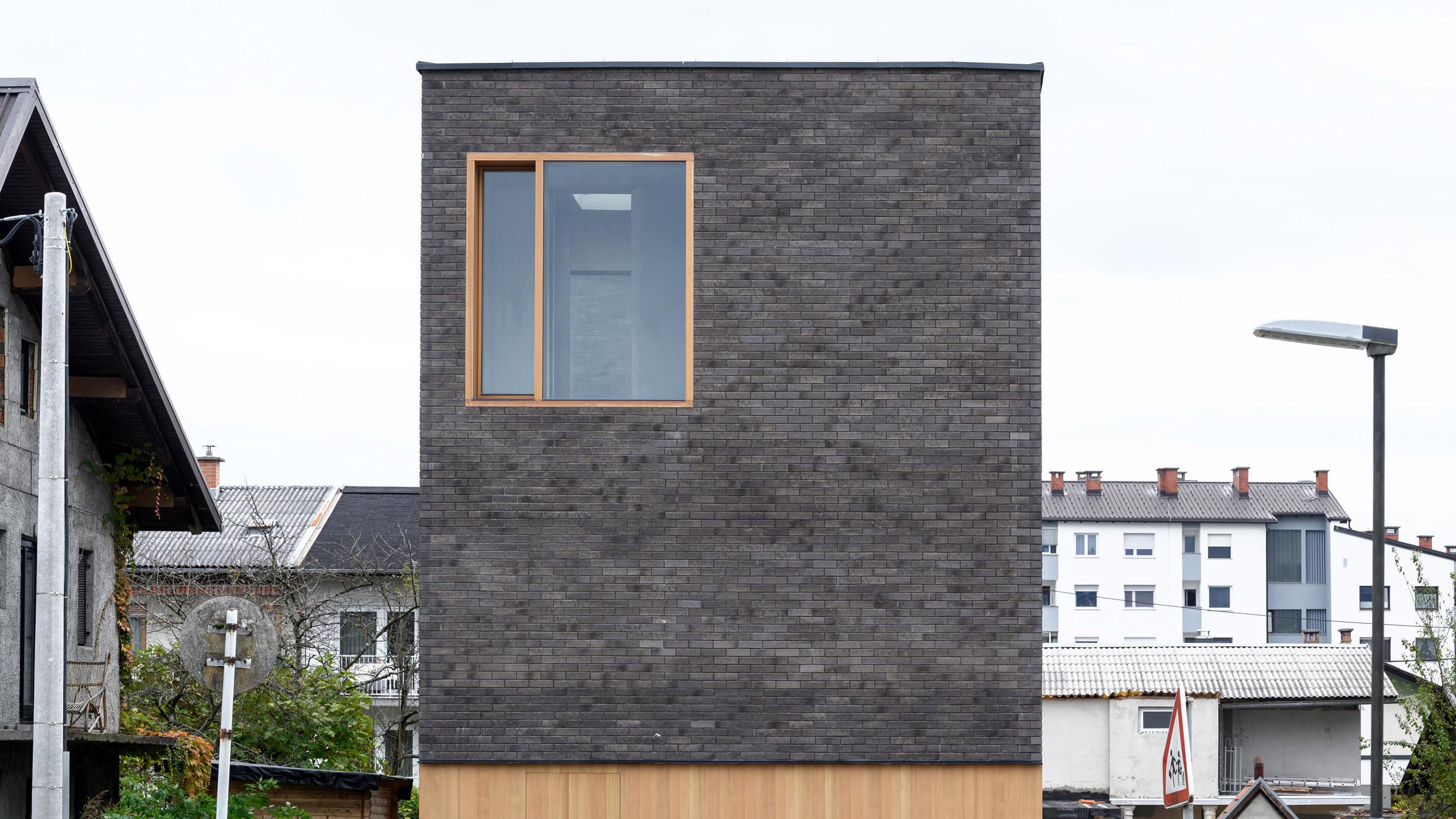 Brick facade of The Double Brick House by Arhitektura
