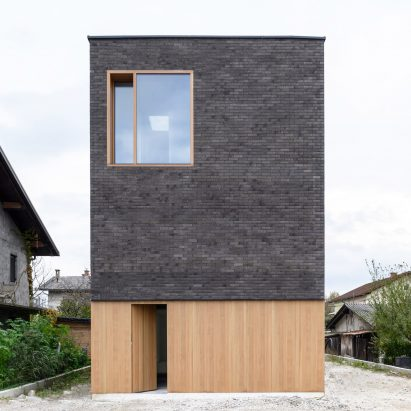 Front elevation of The Double Brick House by Arhitektura