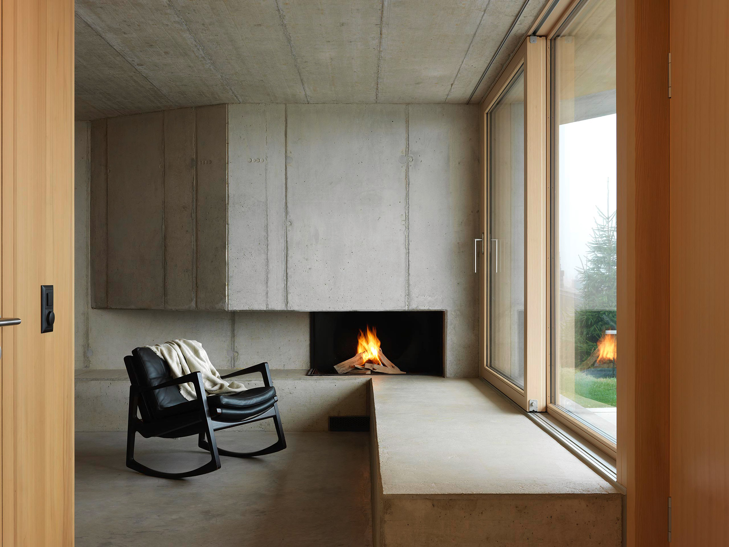 Sitting room with concrete fire place