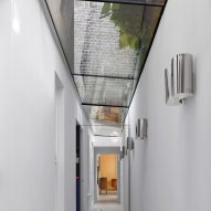 Glass-roofed garden passage in Hampstead House by Dominic McKenzie Architects