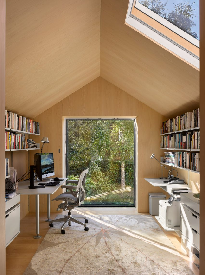View through window of first-floor office in Hampstead House by Dominic McKenzie Architects