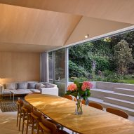 Dining room and lounge space in Hampstead House by Dominic McKenzie Architects