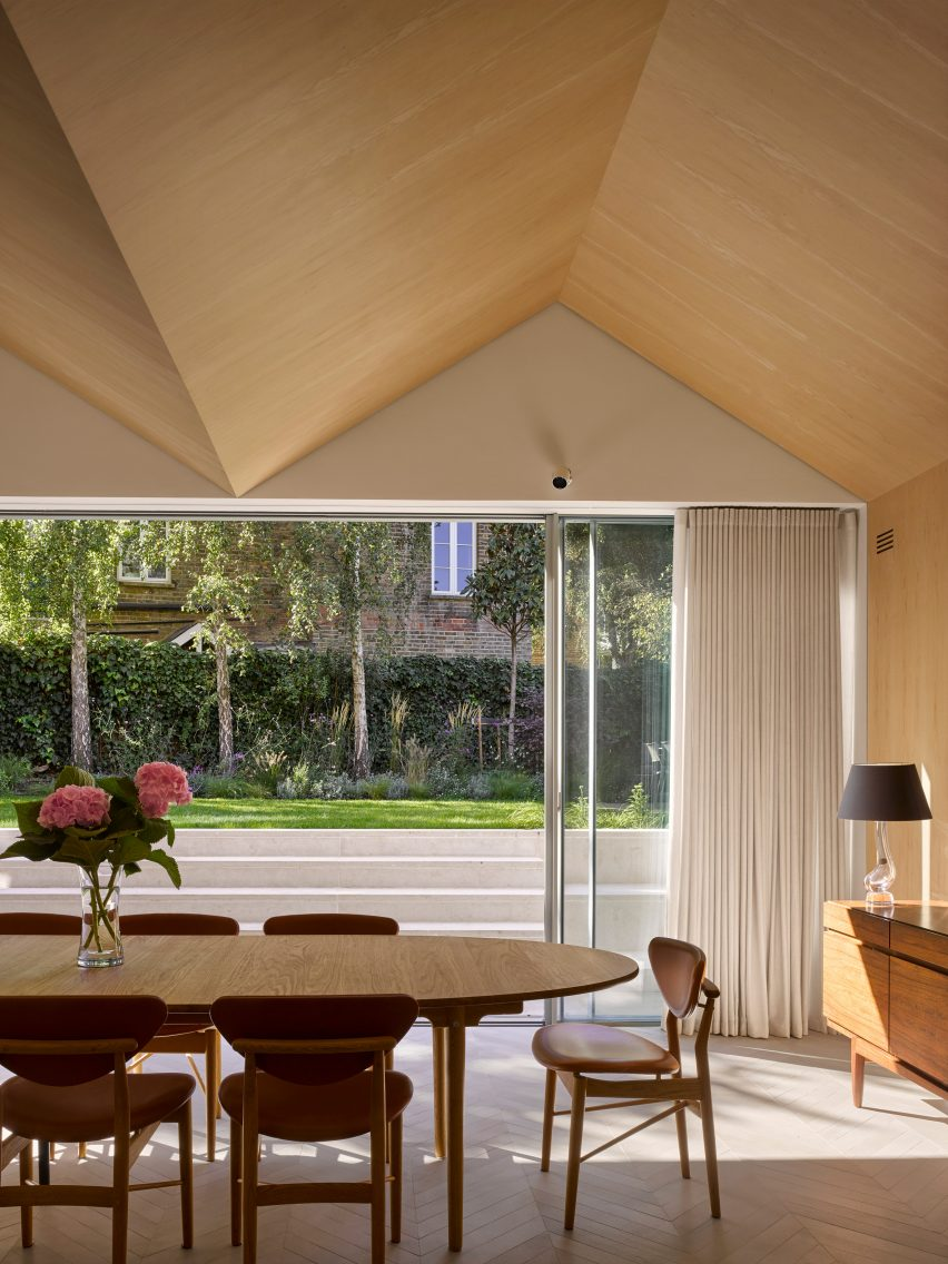 Dining table in Hampstead House by Dominic McKenzie Architects