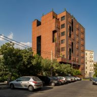 Hooba Design Group clads Tehran office building in brick panels that adjust to the sunlight