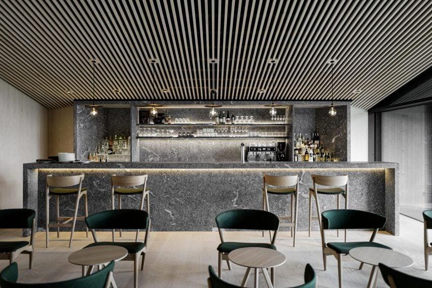 A hotel restaurant with a gneiss bar
