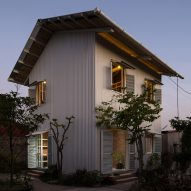 H&P Architects designs white corrugated-metal house in Hai Duong