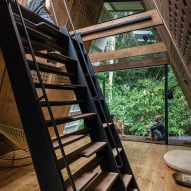 The alternating tread stair inside of the Huaira cabin by Diana Salvador and Javier Mera in Ecuador