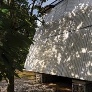 The Tetra Pak walls and roof of the Huaira cabin by Diana Salvador and Javier Mera in Ecuador
