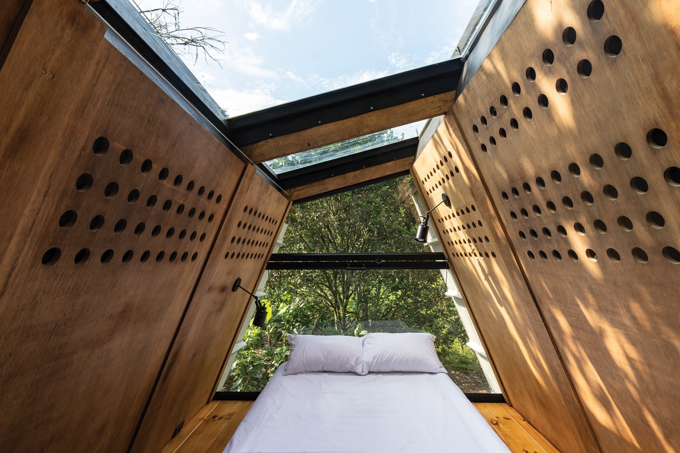 The bedroom inside the Huaira cabin by Diana Salvador and Javier Mera in Ecuador