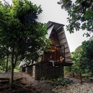 Prefabricated Huaira cabin nestles within verdant farmland in Ecuador