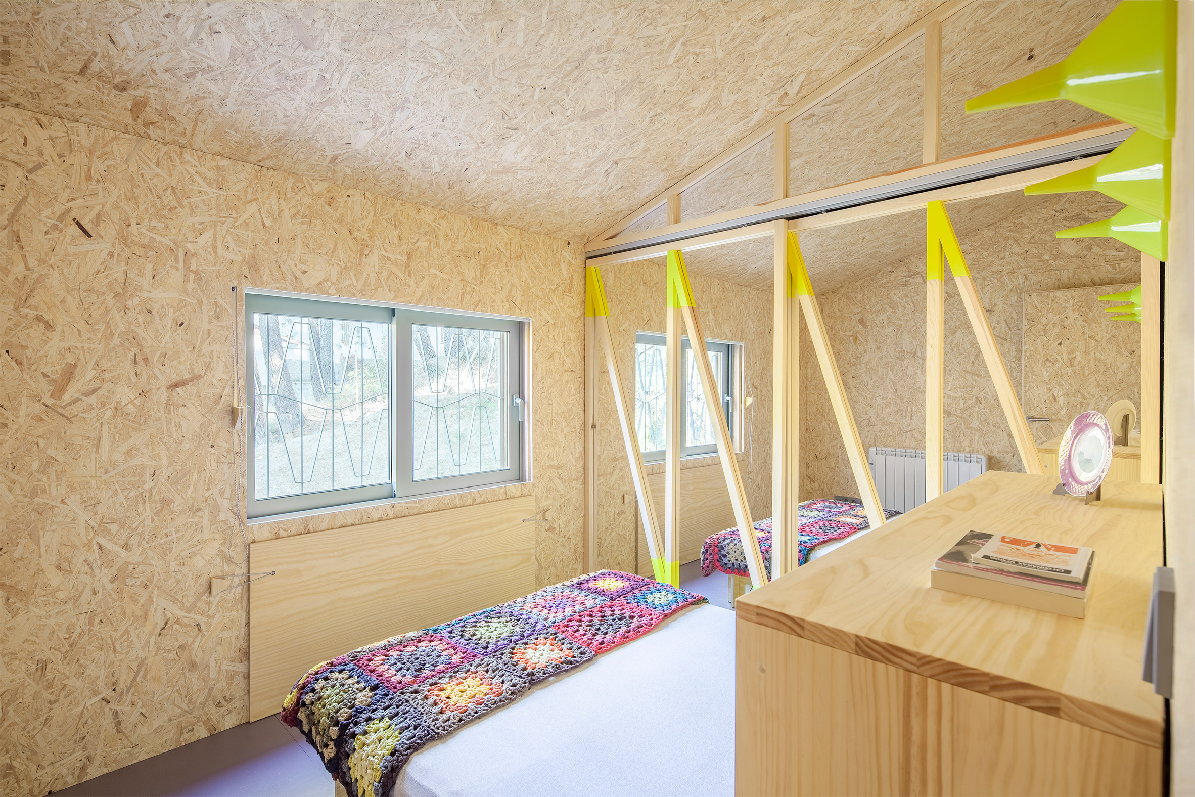 Fold out bed in timber cabin