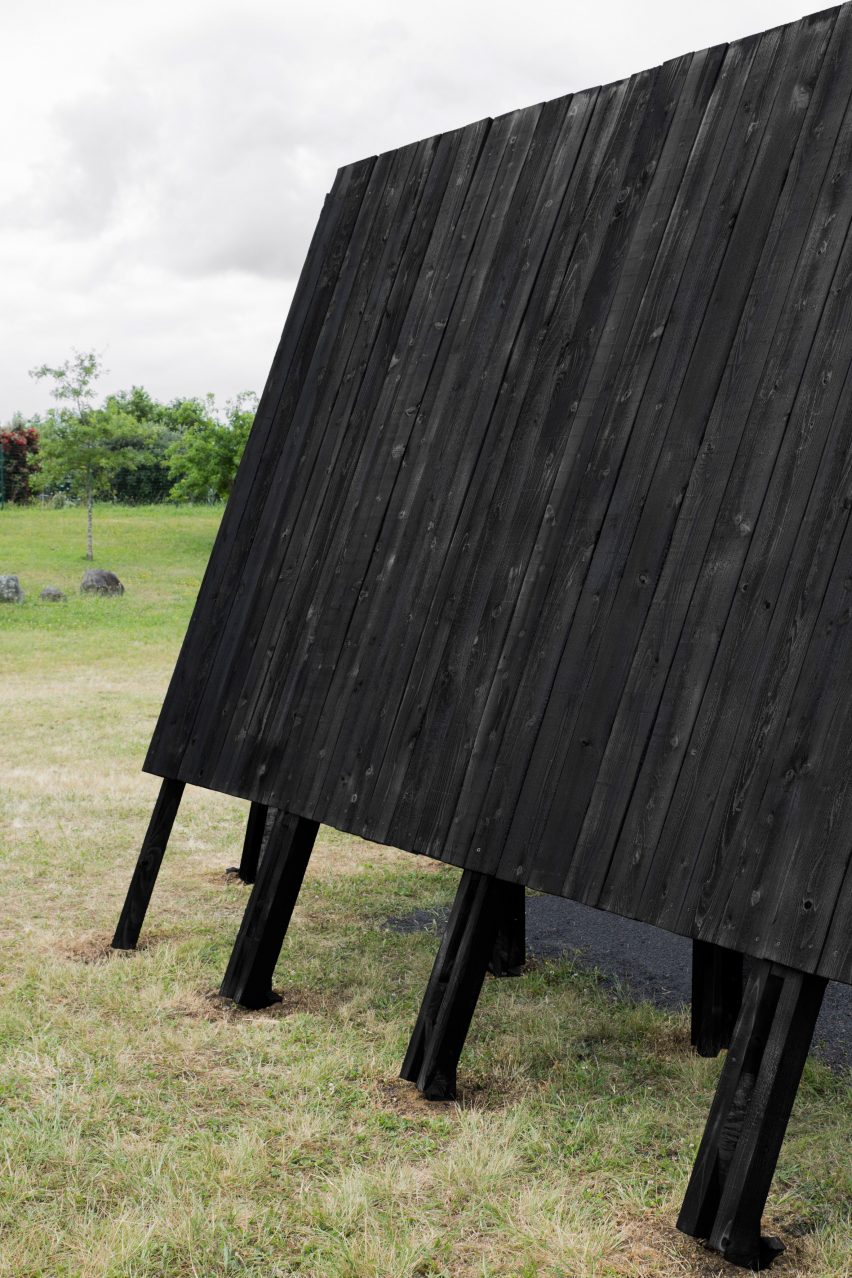 The charred-wood exterior of the Inbetween Pavilion by Pontoatelier