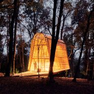 Small La Invernada cabin glows in Chilean forest at night