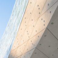 The concrete arch of the Le Monde Headquarters in Paris by Snøhetta
