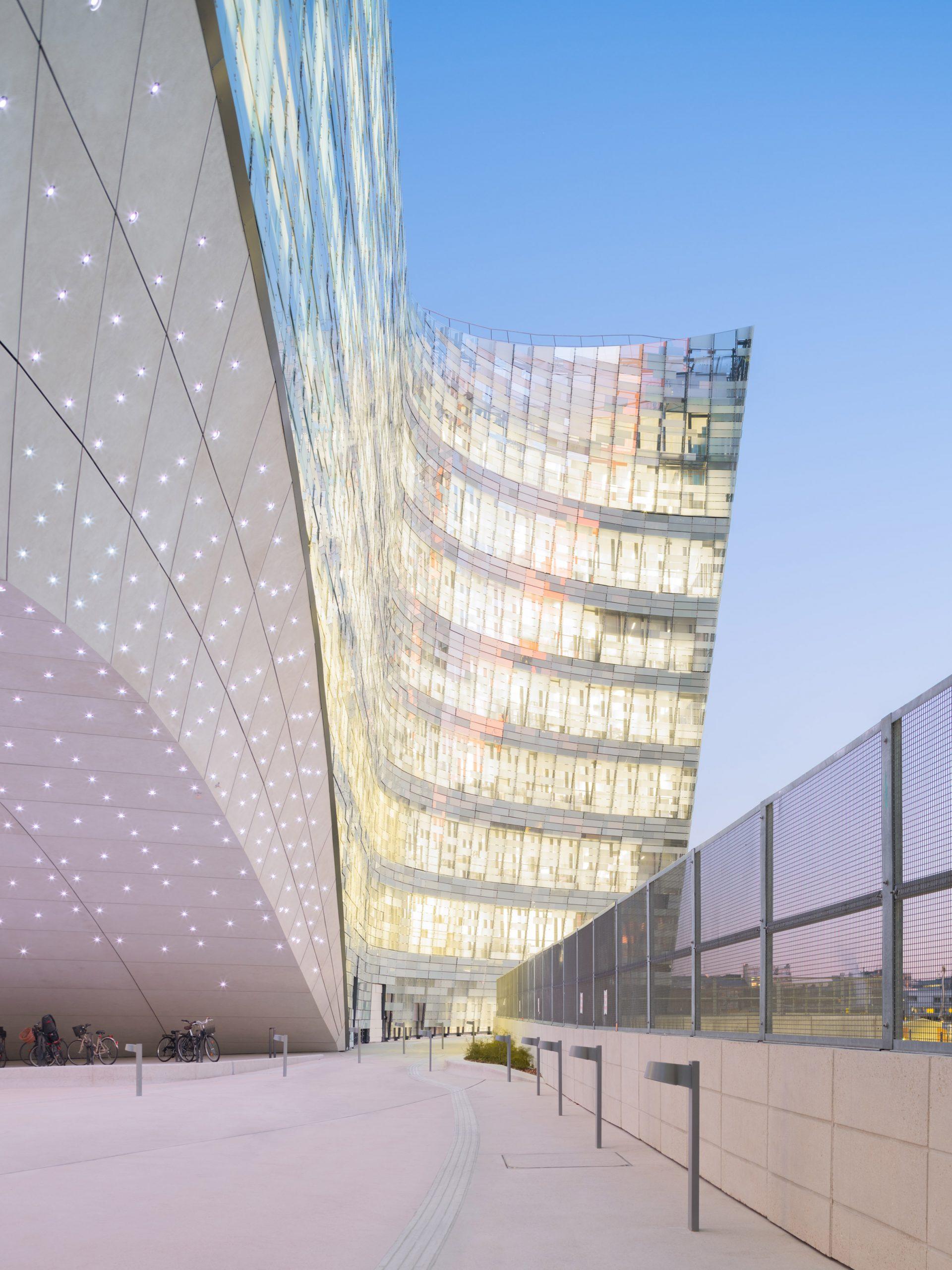 The transparent facade of the Le Monde Headquarters in Paris by Snøhetta