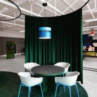 Green curtains in LOQI Activity Office by Studio Aisslinger