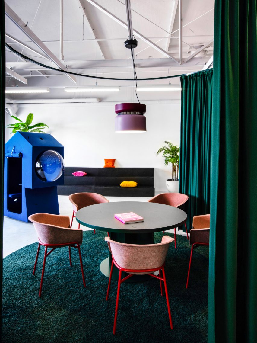 Meeting booth and work capsule in LOQI Activity Office by Studio Aisslinger
