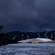MAD unveils sinuous conference centre nestled amongst Chinese mountains