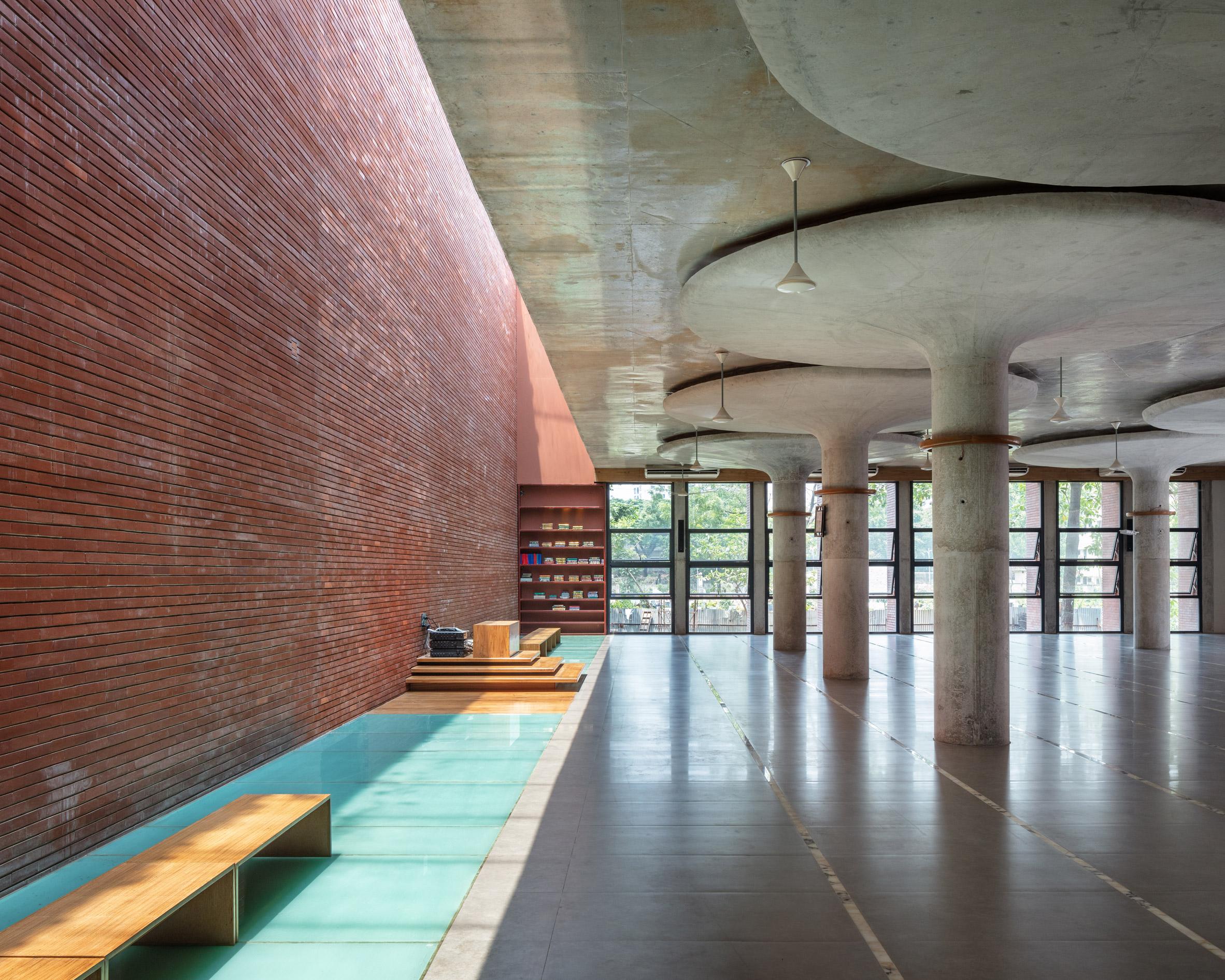 Mushroom-shaped concrete columns in prayer room