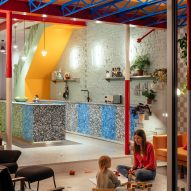 Night view of kitchen at Mountain View by CAN Architecture