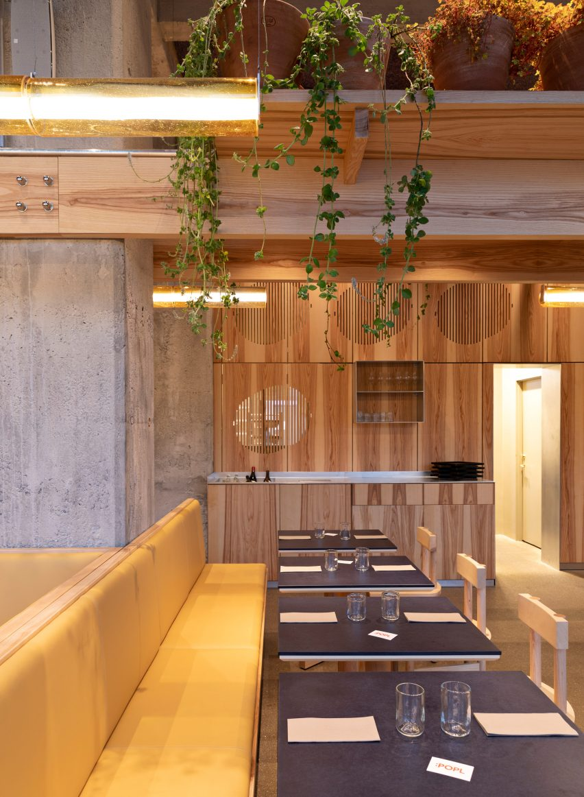 Yellow leather seats in POPL burger restaurant by Spacon & X and e15 for Noma