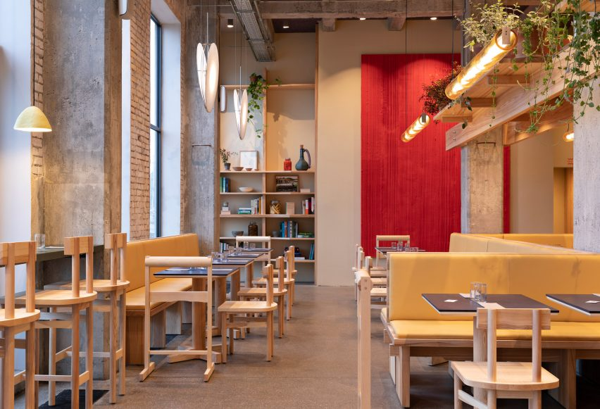 Red and yellow tones in POPL burger restaurant by Spacon & X and e15 for Noma