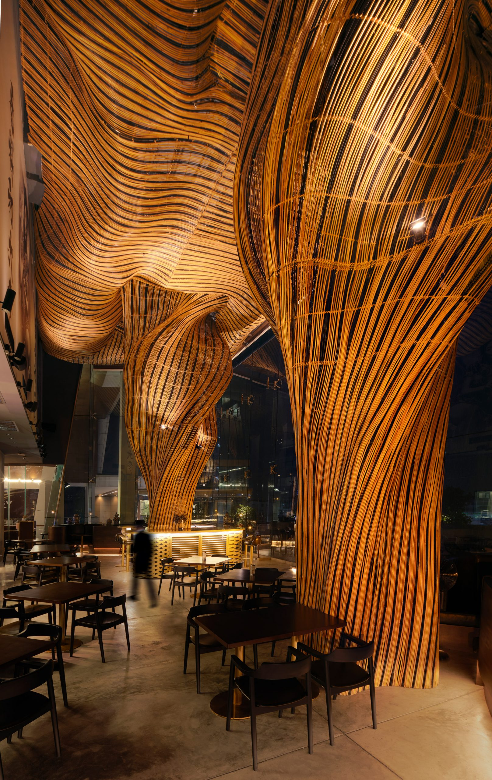 Two rattan pillars at Spice and Barley by Enter Projects Asia
