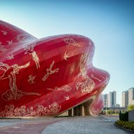 Steven Chilton Architects wraps Guangzhou theatre in tattoo-imprinted cladding
