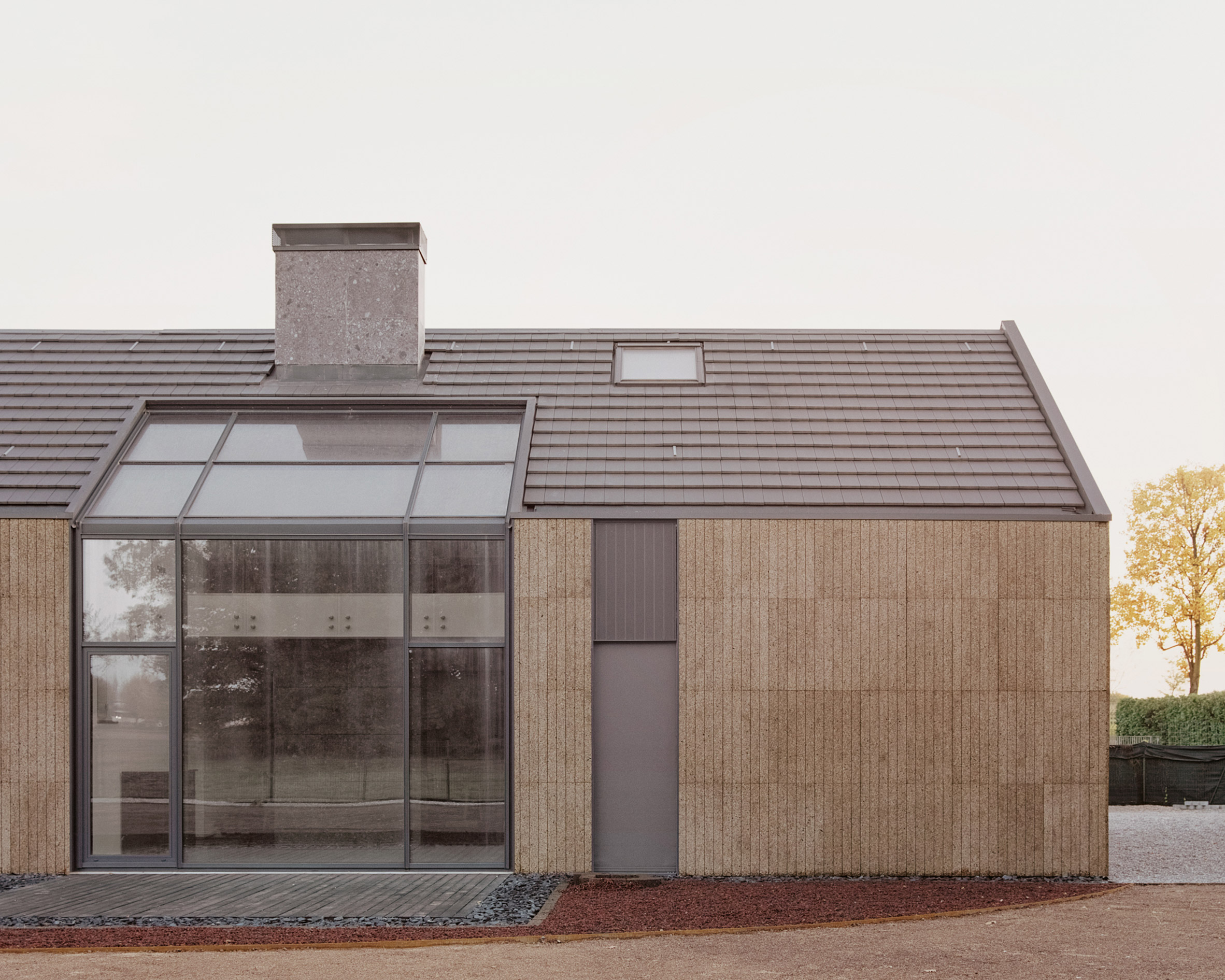 The side elevation of The House of Wood, Straw and Cork by LCA Architetti