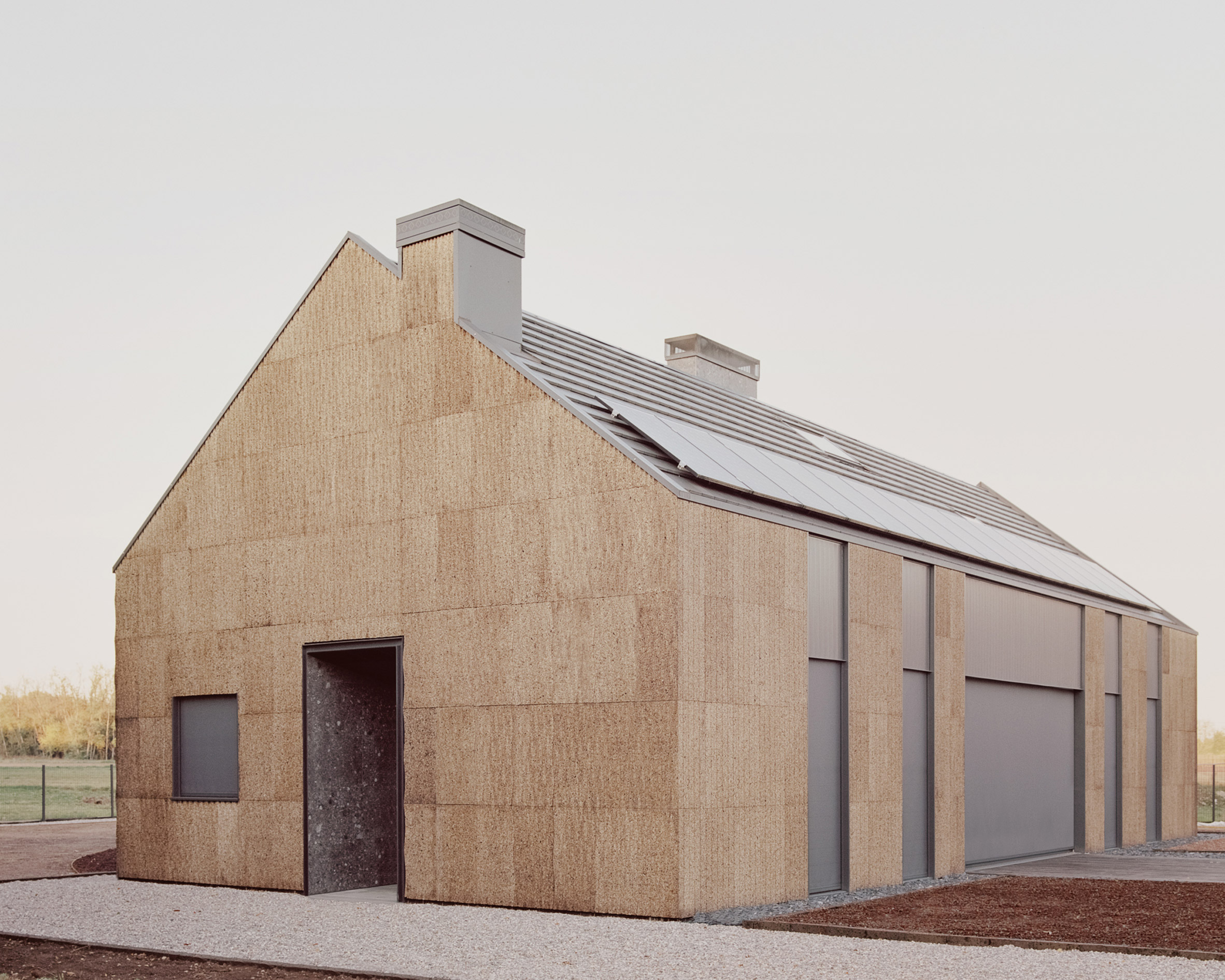 The exterior of The House of Wood, Straw and Cork by LCA Architetti