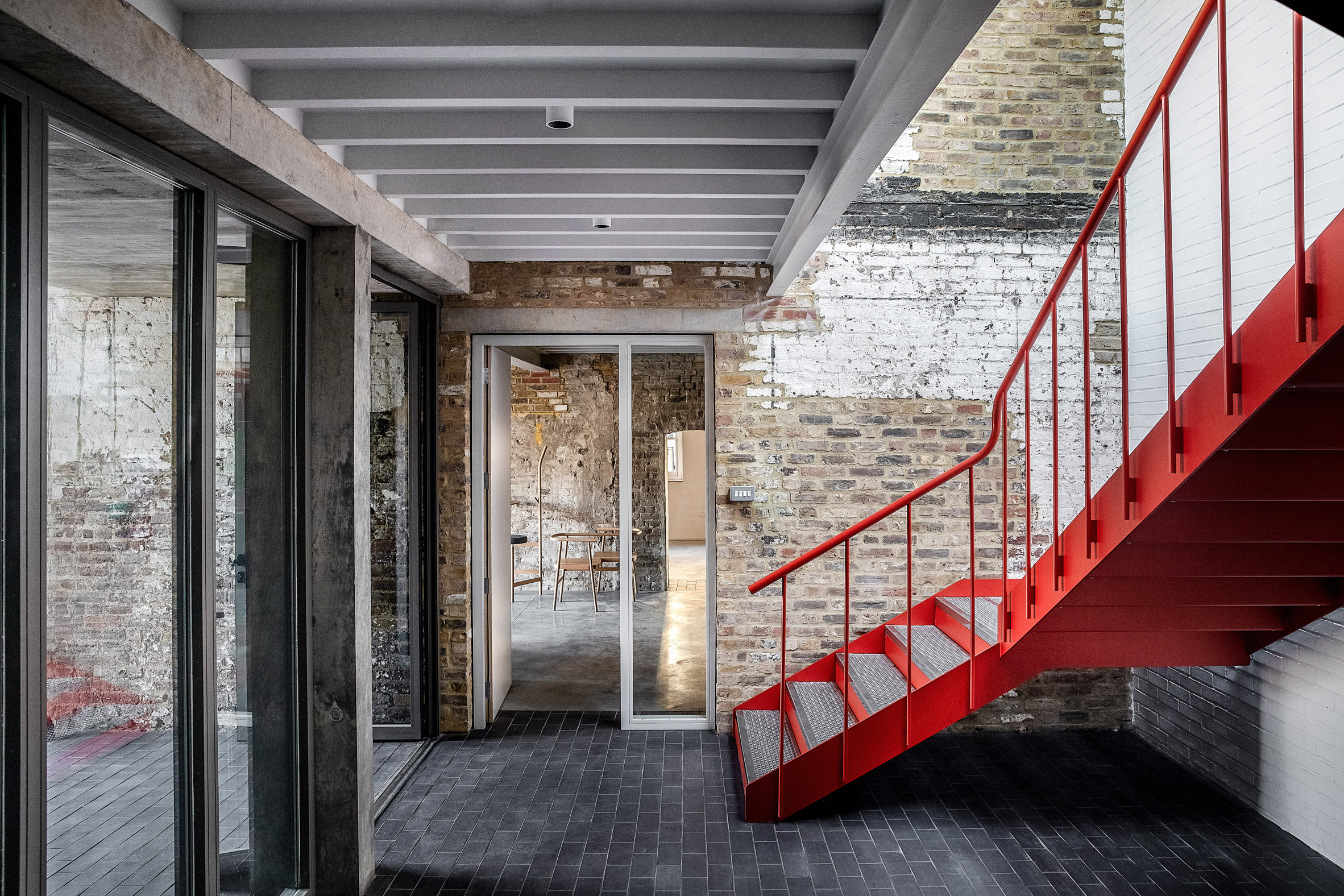 Red staircase at Yorkton Workshops by Pearson Lloyd and Cassion Castle Architects