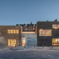 Exterior of Yorkton Workshops by Pearson Lloyd and Cassion Castle Architects at night