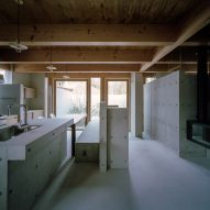 The kitchen of a concrete residence in Japan by FujiwaraMuro Architects