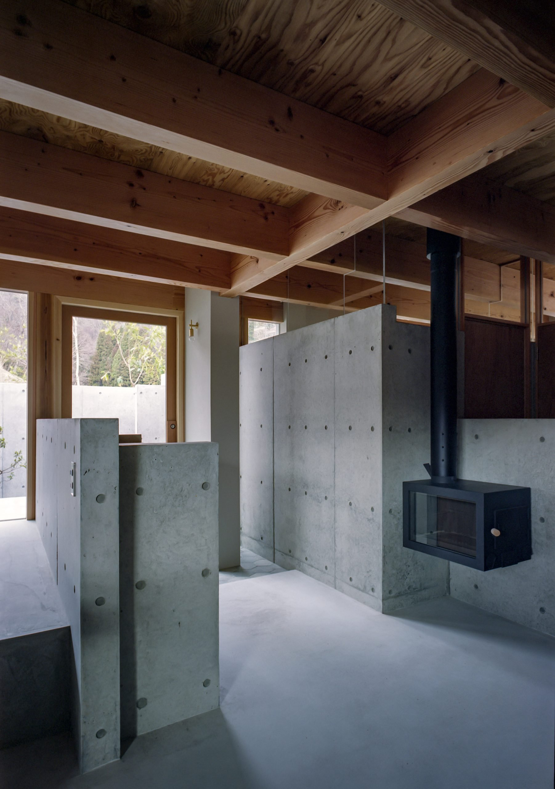 The concrete and wooden interiors of a Japanese house by FujiwaraMuro Architects