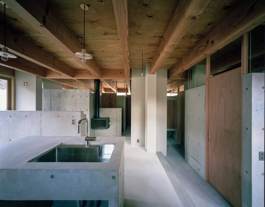 The concrete kitchen and dining room by FujiwaraMuro Architects