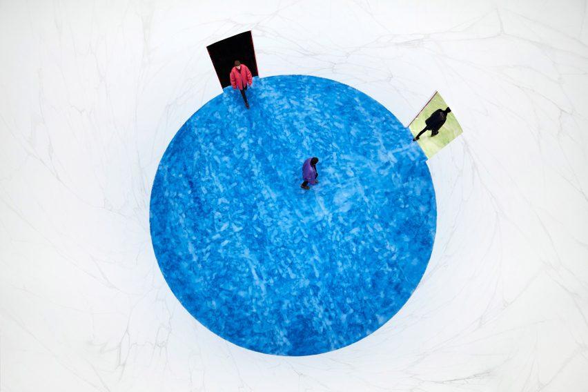 blue fur floor in circular room at Prada show by AMO