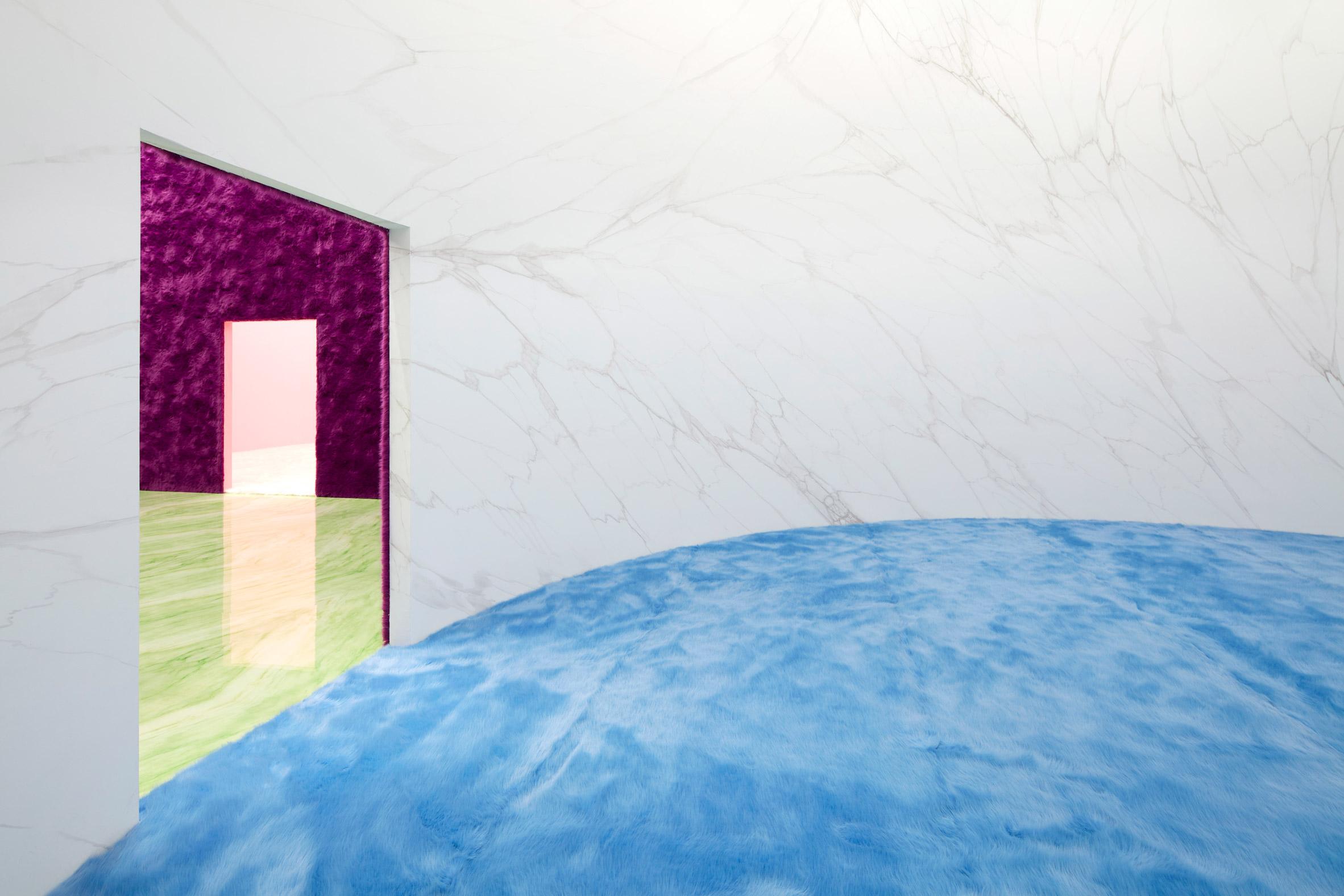 white marble walled circular room at Prada show