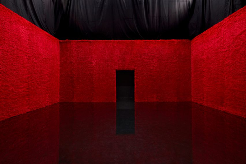 red faux fur clad room at Prada show by AMO