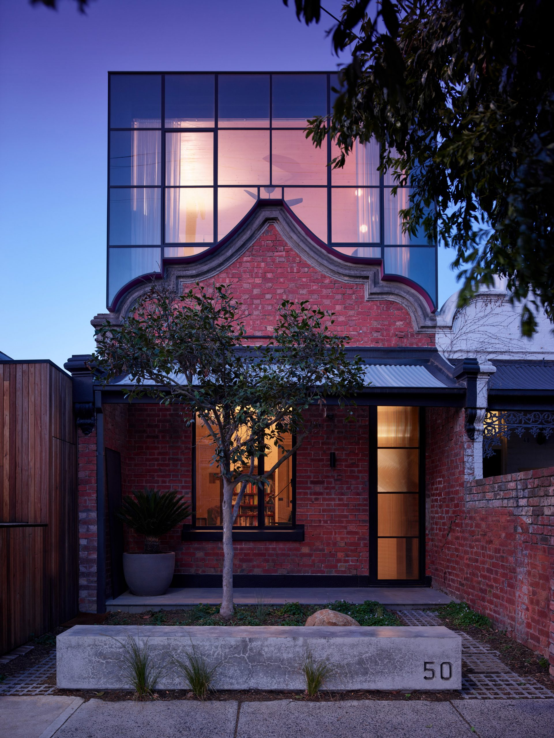 Steel and glass box sits atop original facade of Melbourne home