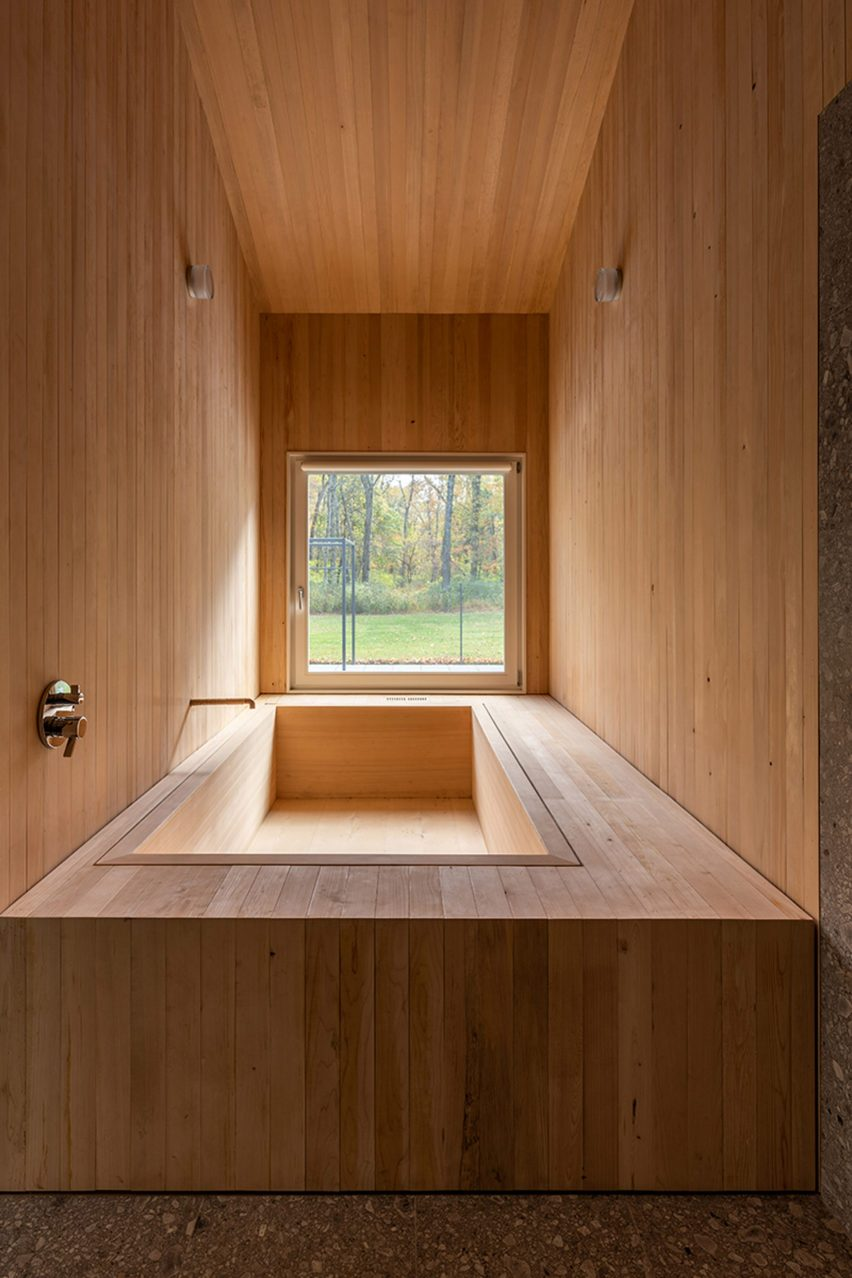 Wooden Japanese sunken bath with a view