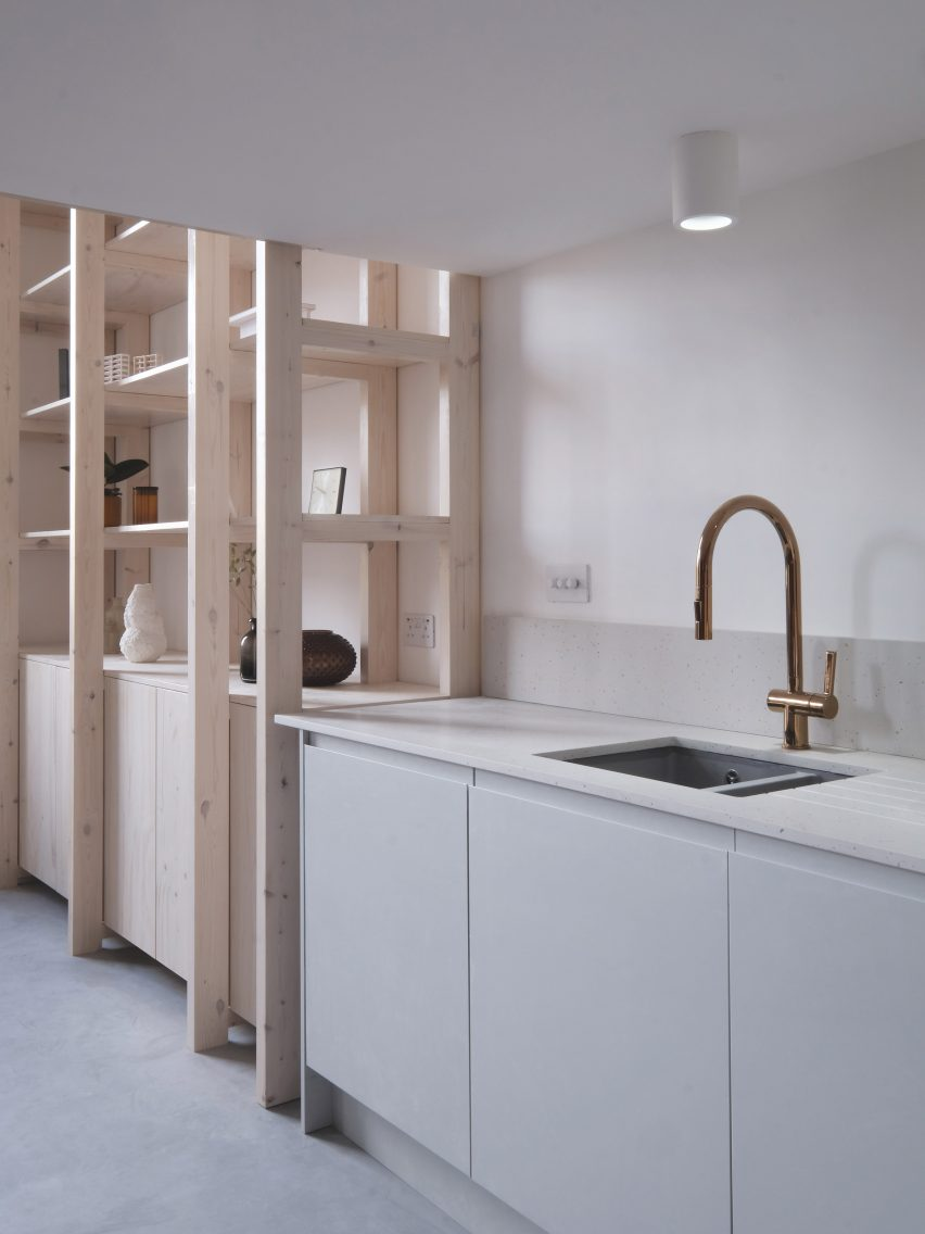 Kitchen and wooden shelving unit from Bow Quarter Apartment interior