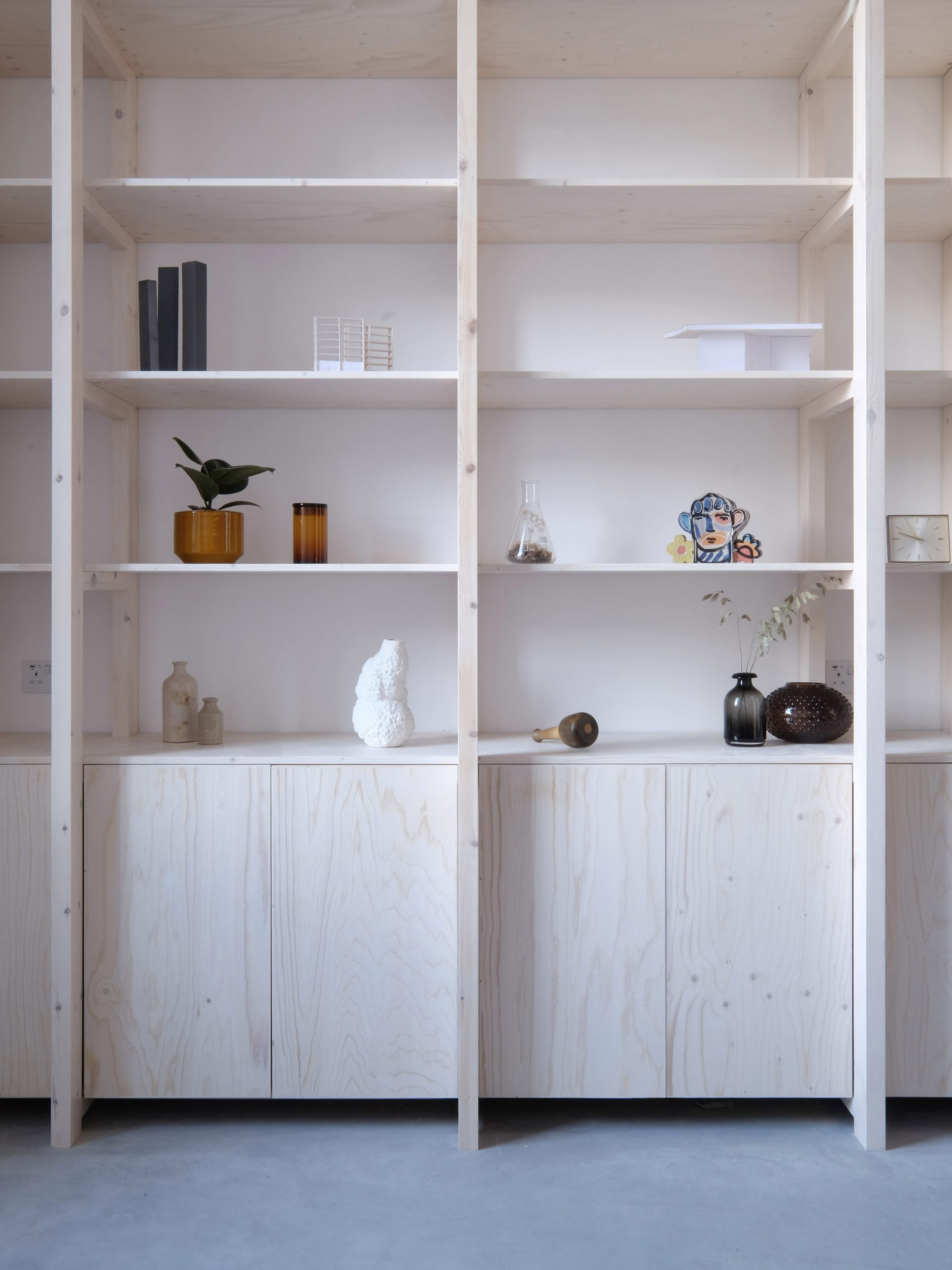 Wooden shelving unit from Bow Quarter Apartment interior by EBBA Architects