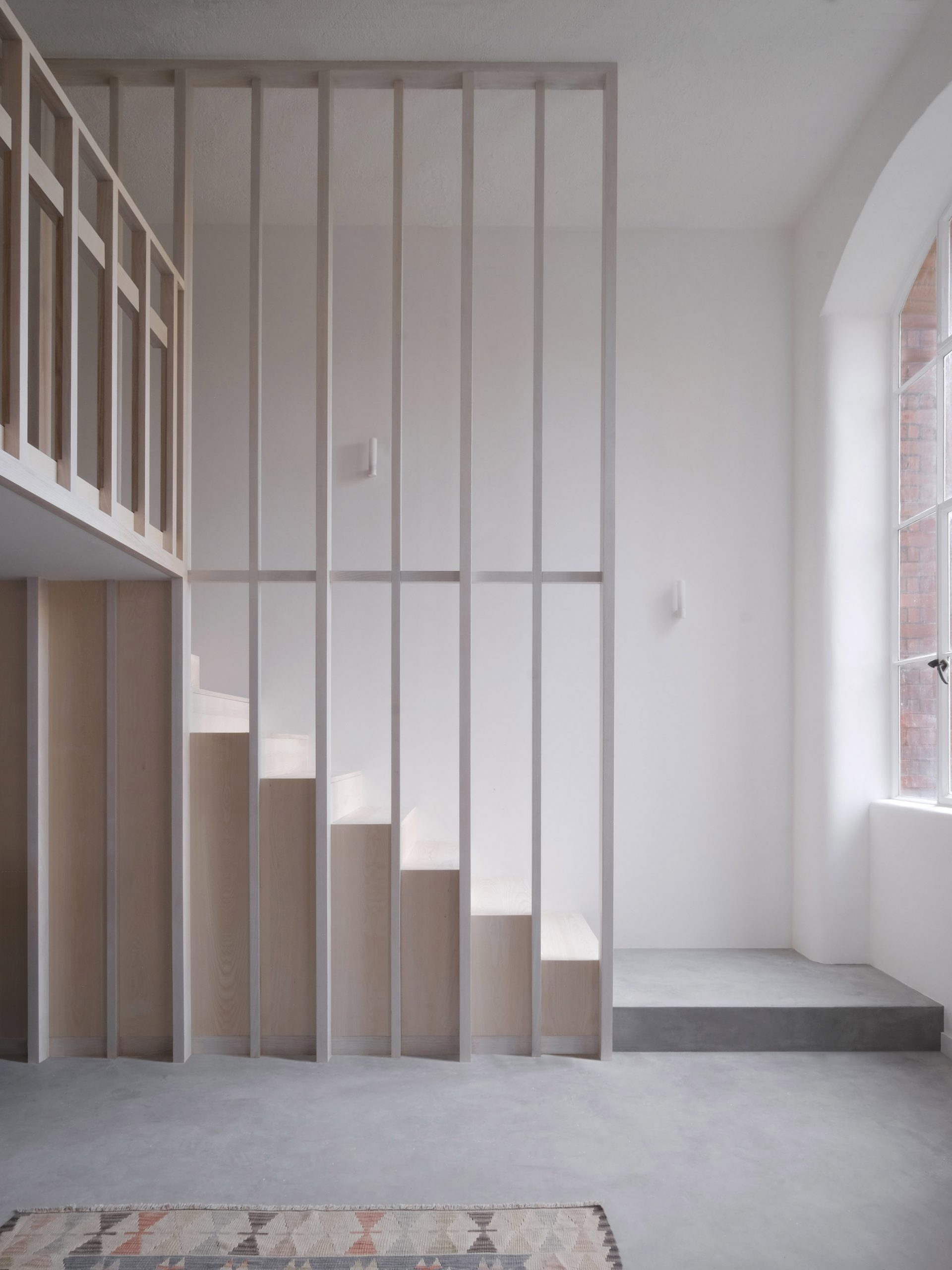 Wooden staircase from Bow Quarter interior by EBBA Architects