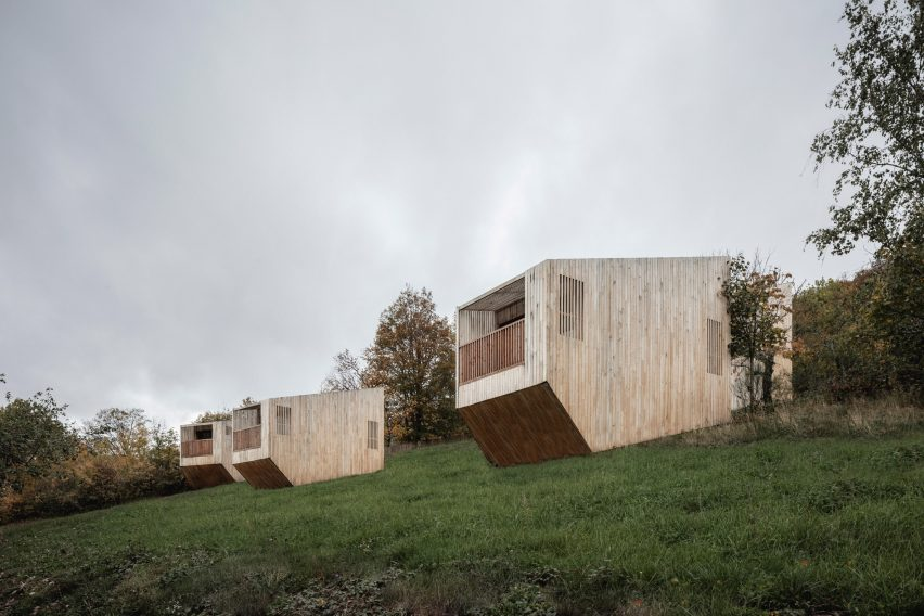 Wooden cabins scattered across grass