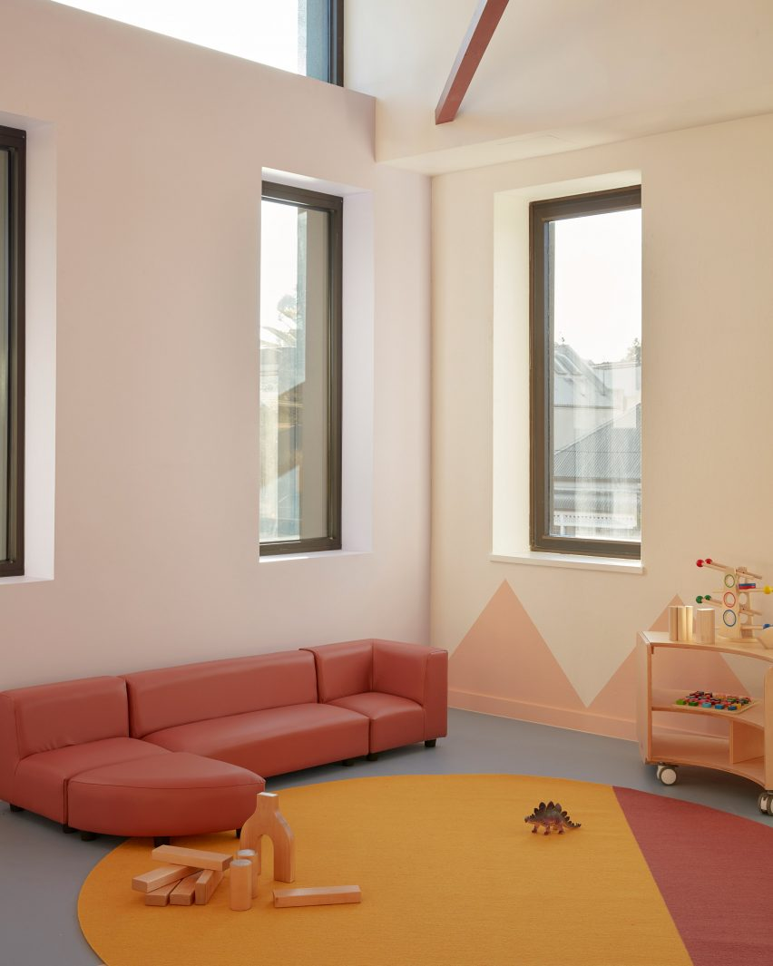 Pink sofa in Brighton Early Learning Centre by Danielle Brustman