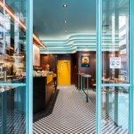 The blue glass door entrance to Caffettiera Caffé Bar